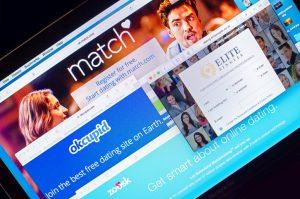 London, UK - June 4, 2015: various dating websites displayed on computer screen